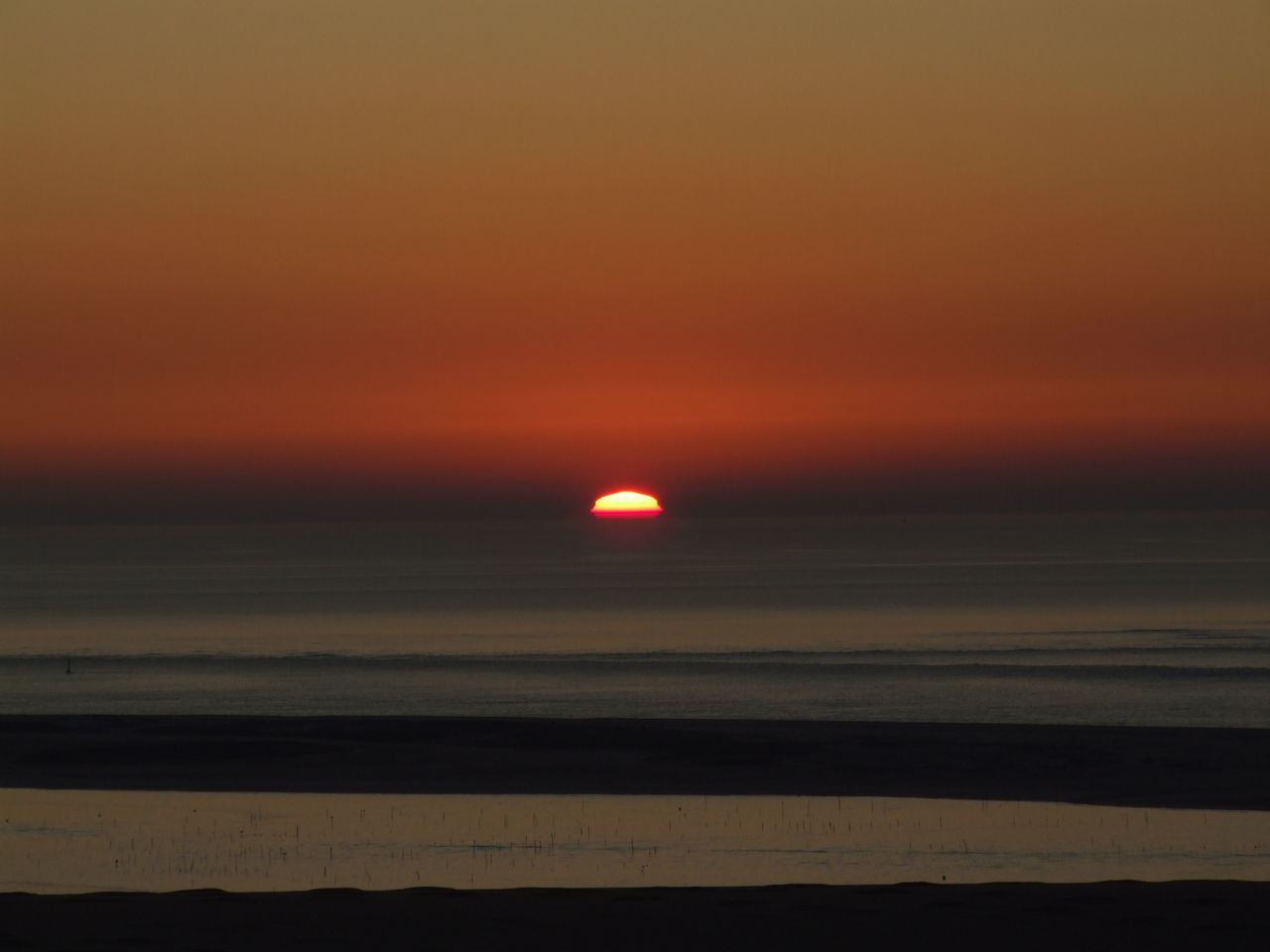 sunset, beauty in nature, scenics, nature, sea, orange color, tranquil scene, tranquility, horizon over water, sky, sun, outdoors, idyllic, water, no people, beach, moon, landscape, astronomy, day