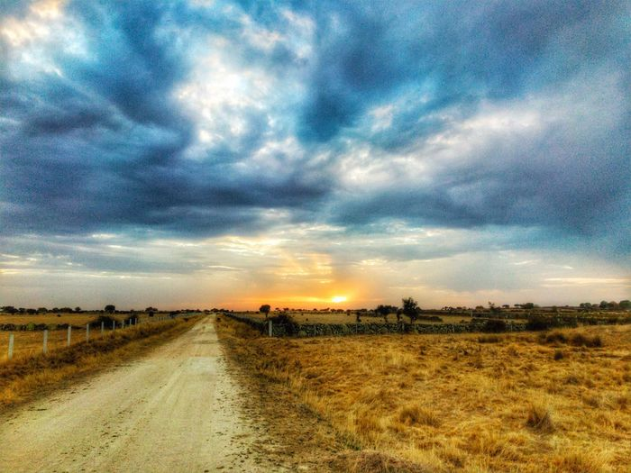 Way The Way Forward Landscape Cloud - Sky Scenics Field Tranquil Scene Nature Tranquility Sunset Beauty In Nature Rural Scene Outdoors Dehesa Environment Rural Path Rural Life Rural Road Road Path Pathway Path In Nature Landscape_Collection Long Way Advance