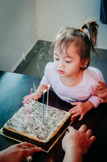 Child Real People Childhood Indoors  One Person Innocence Holding Lifestyles Girls Cute Females Home Interior Front View Women Food High Angle View Looking