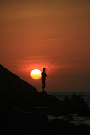 fishing sunset INDONESIA Fisherman Fish Aceh Culture Aceh Full Length Sunset Standing Silhouette Sun Dusk Men Orange Color Sky Atmospheric Mood Dramatic Sky Fishing Romantic Sky Fishing Pole Calm Coast Fishing Rod Cumulus Storm Cloud Fishing Net Sky Only Moody Sky Fishing Tackle Horizon Over Water Lightning Catch Of Fish Dramatic Landscape Forked Lightning Fishing Equipment