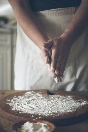 One Person Human Hand Preparation  Food Hand Preparing Food Food And Drink Dough Baker Baking Bakery Pizza Midsection Real People Making Human Body Part Occupation Chef Kneading Sweet Food Flour Apron Cooking Kitchen Preparation