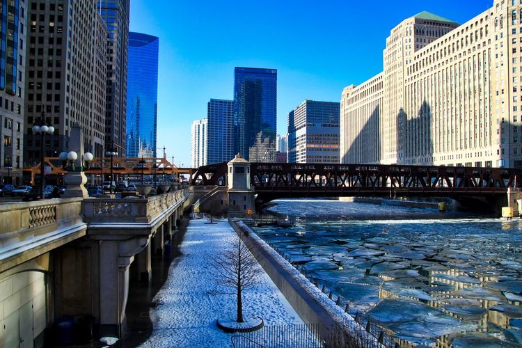 Riverwalk next to frozen river with chunks of ice in Chicago downtown loop. Footprints Riverwalk Footprints In The Snow Downtown Chicago Chicago Loop Chicago Chicago River Chicago Riverwalk Downtown Chicago Elevated Track Frozen Ice January Reflection Winter Architecture Bridge - Man Made Structure Bridgehouse Building Exterior Built Structure City Cracked Ice Day Drawbridge  Frozen River Ice Chunks Outdoors River Shadow Water Shades Of Winter