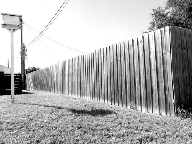 Monochrome Photography Fence Outdoors Built Structure Repetition Lines Blackandwhite In A Row Nature Barrier Neighborhood Privacy Suburbia Darkness And Light Wooden Fence Texture The Grass Is Greener On The Other Side Florida Boundary Diminishing Perspective Suburban Exploration Beautifully Organized Repeating Patterns Pattern, Texture, Shape And Form Light And Shadow
