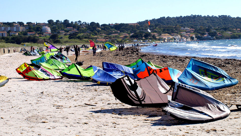 Beach Sand Outdoors Day Sunlight Vacations Summer Sea Water Nature Multi Colored No People Tree Sky Hyères Les Palmiers Le Var Extreme Sports Surfing Sportsman Adventure Travel Destinations Healthy Lifestyle Aquatic Sport EyeEm Diversity
