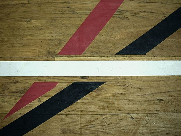 High angle view of arrow sign on wooden table