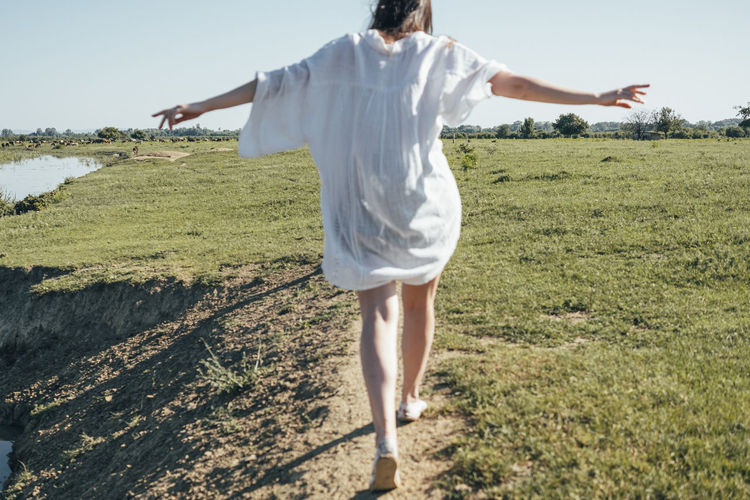 Rear View One Person Real People Land Nature Day Leisure Activity Full Length Lifestyles Casual Clothing Walking Adult Field Standing Non-urban Scene Grass Women Landscape Outdoors Human Arm My Best Photo