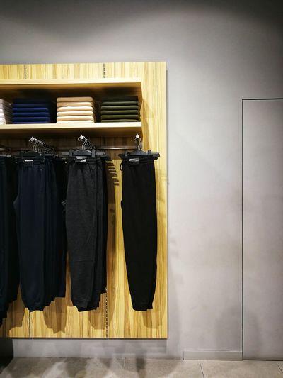 Clothes hanging on rack Neat Coathanger Hanging Locker Room Fitting Room Closed Locker Closed Door Door Coat Hook Door Knocker