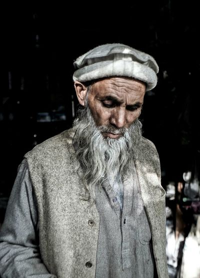 Portrait of a shopkeeper. Human Face Focus On Foreground People And Places Light And Shadow Darkness And Light Dark Shootermag Street Photography VSCO Street EyeEm Gallery Streetphotography Getting Inspired TakeoverContrast Open Edit Person People Portrait Street Portrait Color Portrait Faces Traveling