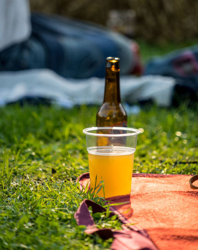 Glass of beer on field