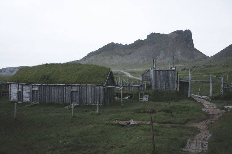 Stokksnes Barrier Beauty In Nature Boundary Day Environment Fence Field Grass Land Landscape Mountain Mountain Range Nature No People Non-urban Scene Outdoors Plant Scenics - Nature Sky Tranquil Scene Tranquility Viking Village Wooden Post
