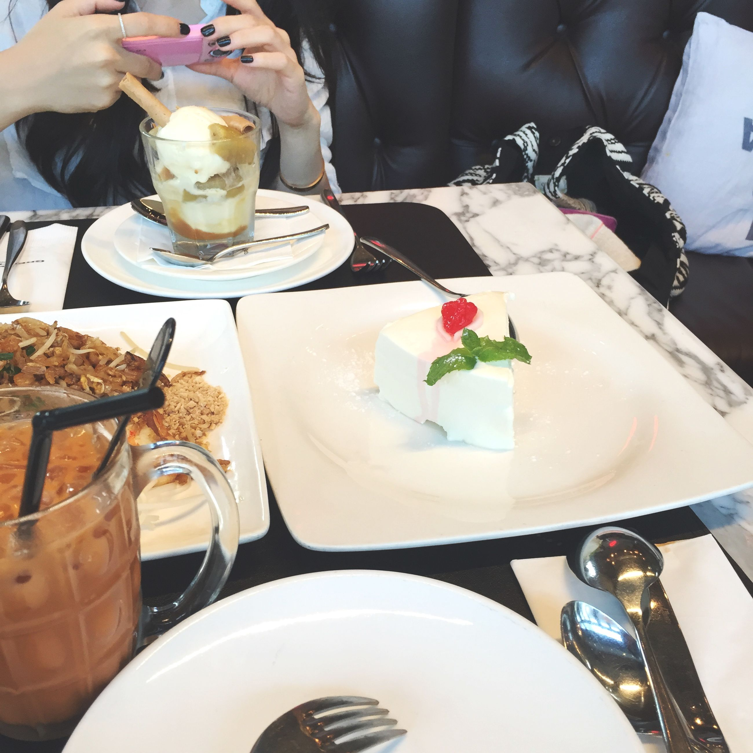 food and drink, freshness, indoors, food, table, plate, ready-to-eat, drink, person, restaurant, high angle view, indulgence, fork, spoon, sweet food, lifestyles, refreshment