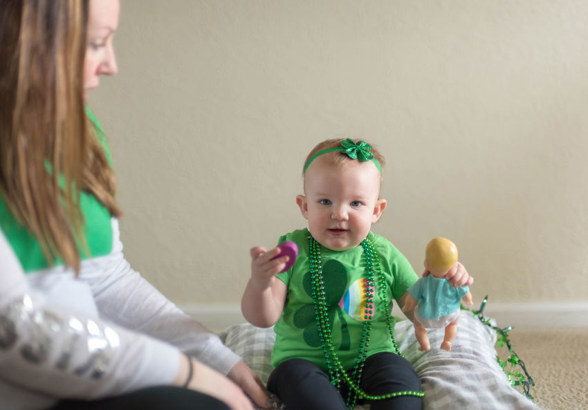 Mother and toddler girl wearing green to celebrate St. Patrick's Day Baby Celebration Family Green Happy St. Patricks Day Holiday Home Home Life Mother And Daughter St. Paddy's St. Patrick's Day Celebrate Decorations Families At Home Irish Lifestyles Little Girl People Portrait Real Life Real People Toddler  Wearing Of The Green