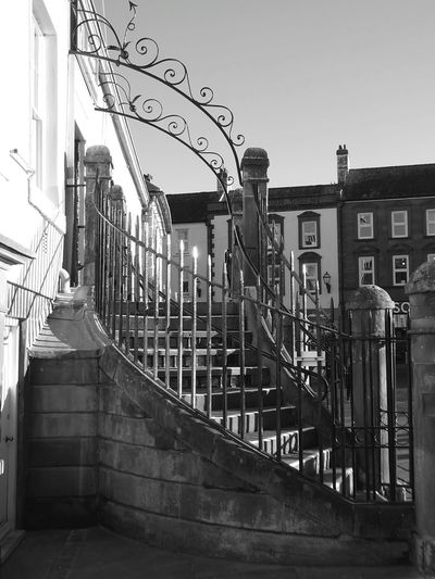 Life is rarely black or white but it's often all the colours of the rainbow... Architecture Curved Staircase Iron Railings Sunshine Black And White Photography Shadows Sun Glistening Chimneys Windows And Doors Sky Outdoors Metal Archway