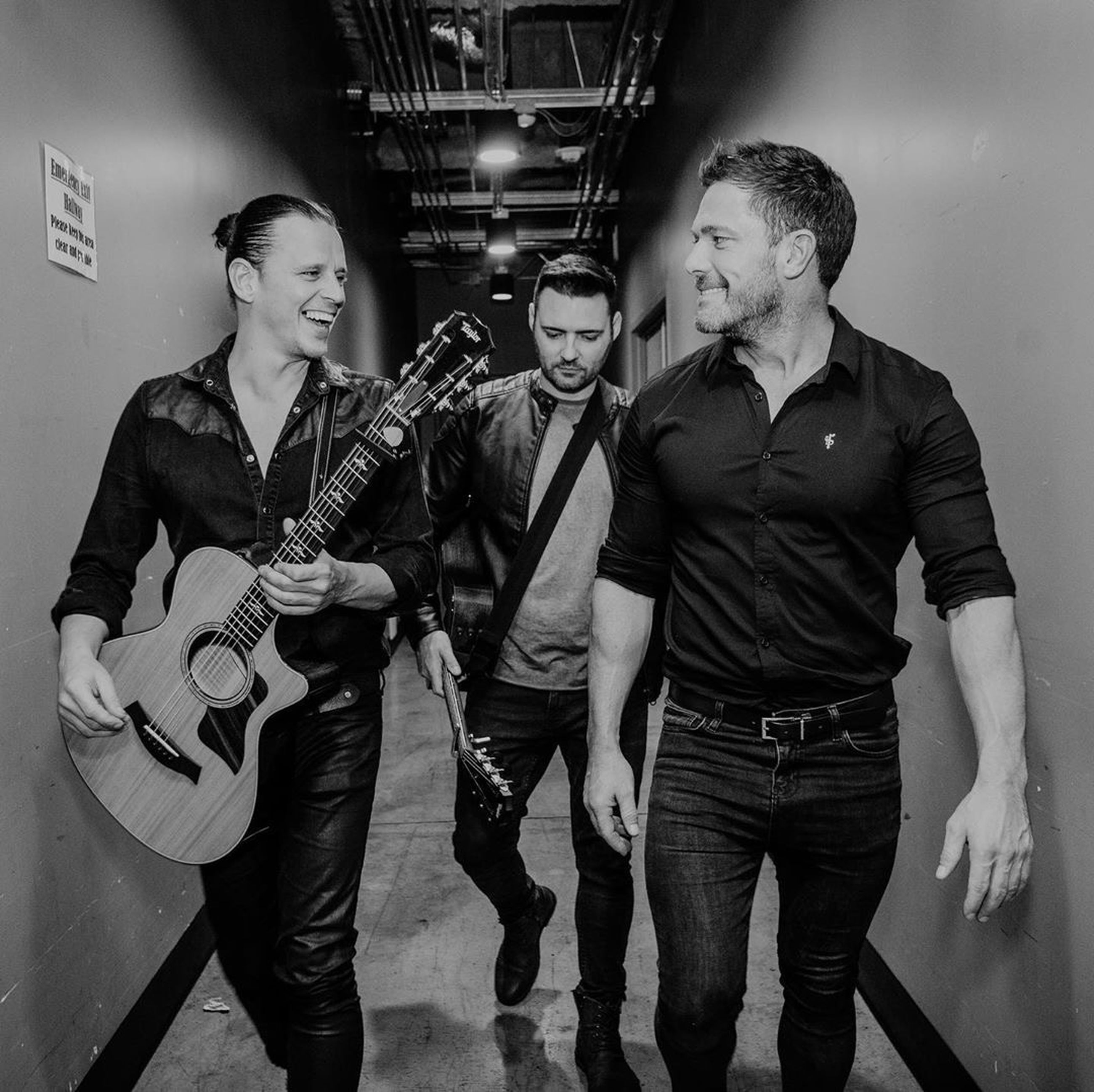 musical instrument, guitar, arts culture and entertainment, music, young men, string instrument, young adult, musician, musical equipment, performance, indoors, real people, three people, togetherness, men, playing, front view, artist, standing, electric guitar
