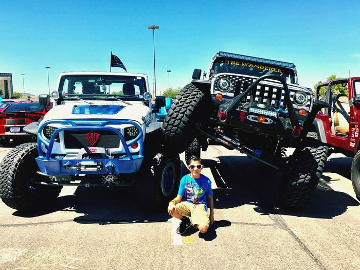 CarShow BombAssCarz SundayFunday Land Vehicle Day Real People Sunlight Transportation Car Outdoors Mode Of Transport Men Architecture Built Structure Clear Sky Full Length Shadow Standing Large Group Of People Road Women Building Exterior Sky