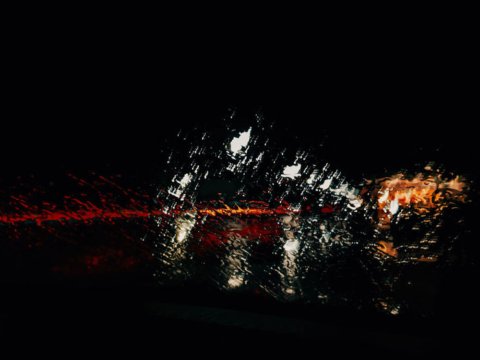 Illuminated firework display over black background
