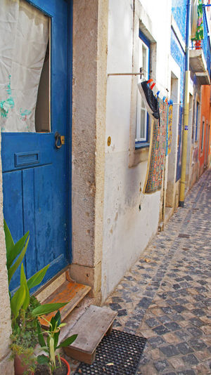 Architecture Blue Door Houses Lissabon, Portugal Angles Architecture Building Exterior Built Structure Day Door Gassen House Lissabon Narrow Street No People Outdoors Streetphotography Travel Destinations Window