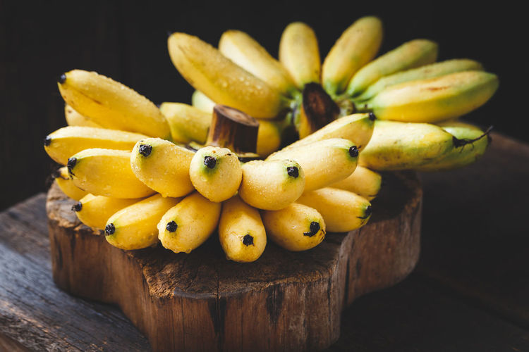 Close-Up Of Wet Bananas On Wooden Table