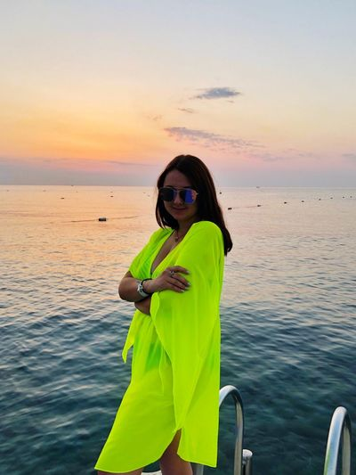 Sea Sky Sunset Water One Person Real People Horizon Over Water Leisure Activity Beauty In Nature Scenics - Nature Beach Lifestyles Horizon Land Glasses Nature Adult Women Outdoors
