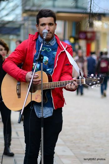 Arts Culture And Entertainment Busker Guitar Men Music Music Musical Instrument Musician One Person Outdoors Performance Playing Real People Street Busker Street Busking