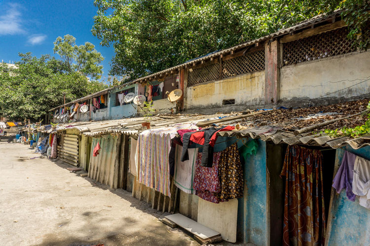 Clothes drying against wall in market