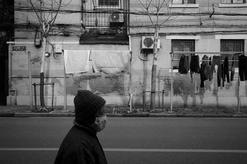 Real People One Person Architecture Built Structure Building Exterior Lifestyles City Street Leisure Activity Side View Men Day Transportation Clothing Window Headshot Looking Standing Blackandwhite Streetphotography