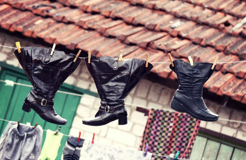 Shoes Footwear Old Vintage Clothesline Hanging Wet Laundry Chores Outdoors Poverty Clean Funny Clothes Boots Here Belongs To Me Telling Stories Differently Up Close Street Photography The Street Photographer - 2016 EyeEm Awards