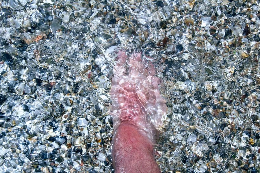 Ankle Deep In Water Barefoot Beach Close-up Day High Angle View Human Body Part Human Leg Low Section Nature One Person Outdoors People Real People Red Tower Red Tower Beach Shallow Water