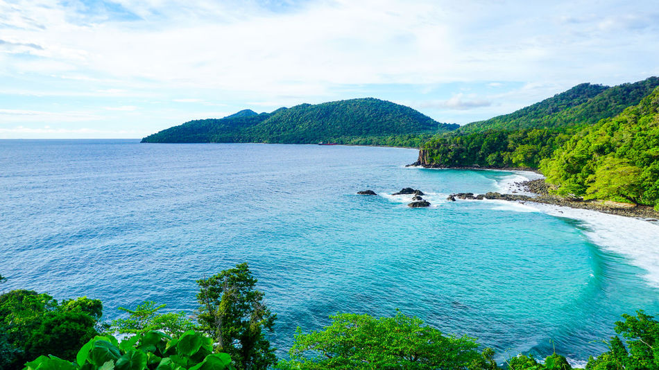 Gua Sarang Cliff with beautiful view of the beach and blue sea water Aceh Aceh, Indonesia Gua Sarang INDONESIA Sabang Acheh Beach Beauty In Nature Cloud - Sky Day Green Color Horizon Over Water Landscape Mountain Nature Outdoors Sabang Island Scenics Sea Sky Tranquil Scene Tranquility Travel Destinations Tree Water