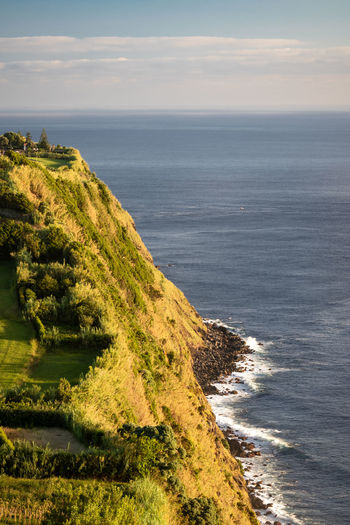 High angle view of coastline from the viewpoint ponta do arnel, sao miguel island, azores, portugal