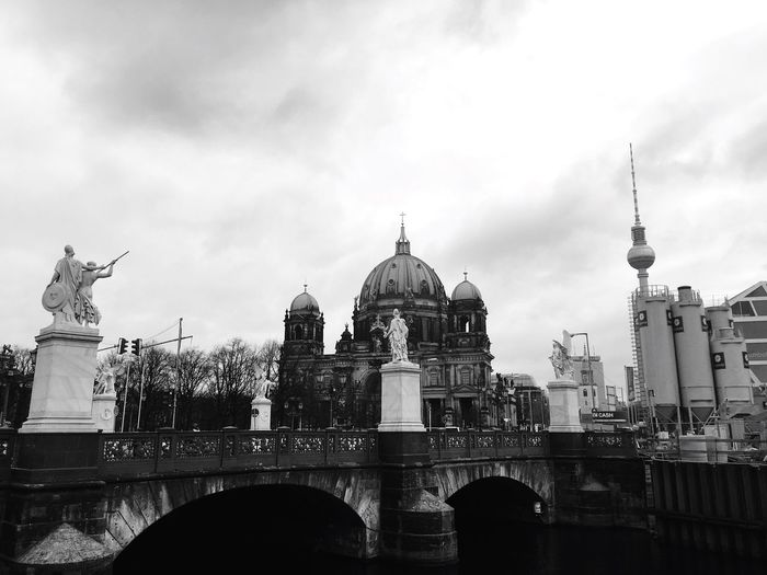 Bridge by berlin cathedral against sky
