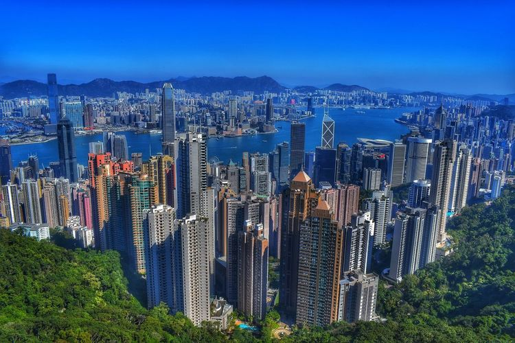 Panoramic view of city and buildings against sky in hong kong
