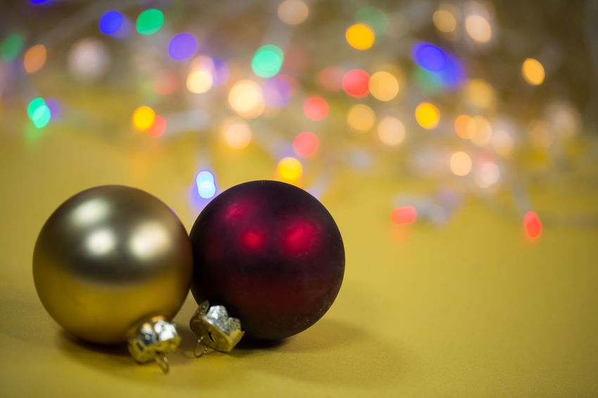 Ball Celebration Christmas Christmas Decoration Christmas Ornament Circle Close-up Decoration Focus On Foreground Geometric Shape Holiday Illuminated Indoors  Multi Colored No People Purple Shape Shiny Silver Colored Sphere Still Life