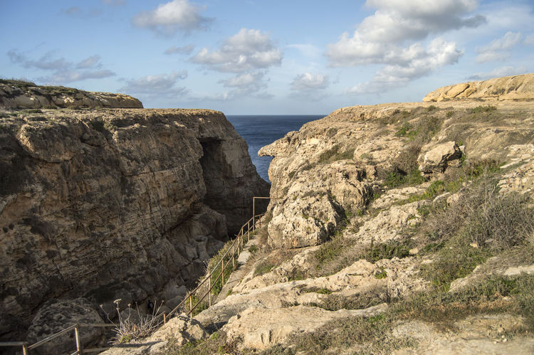 At Wied il-Miellah Gozo Malta Cliff Day Eroded Erosion Geology Gharbetiba Gozo Gozo Island Physical Geography Rock Rock - Object Rock Formation Rocky Rough Sea Sea And Sky Showcase: February Valley Window