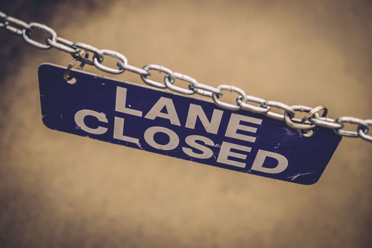 Blue Chain Grocery Store Hanging Lane Closed Looking Down Selective Focus Sign