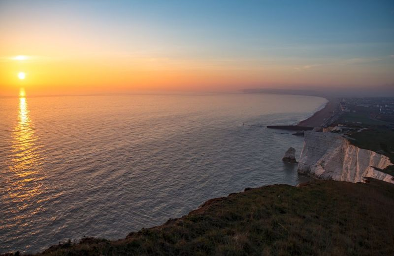 Seaford Sunset By The Cliffs Sundown Sun Seaside Cliffs Sea Sunset Horizon Over Water Beauty In Nature Scenics Tranquility Water No People Admiring The View Calmness Landscape Sunset_collection Waiting To Set Idyllic Outdoors Cliff Edge