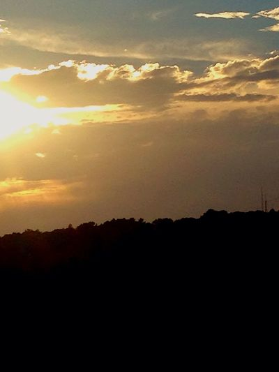 Sunset Silhouette Scenics Tranquil Scene Beauty In Nature Tranquility Nature Sun Idyllic Sky Cloud - Sky Mountain Calm Orange Color Cloud Dark Outdoors Outline Majestic No People