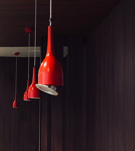 Red pendant lights hanging from ceiling
