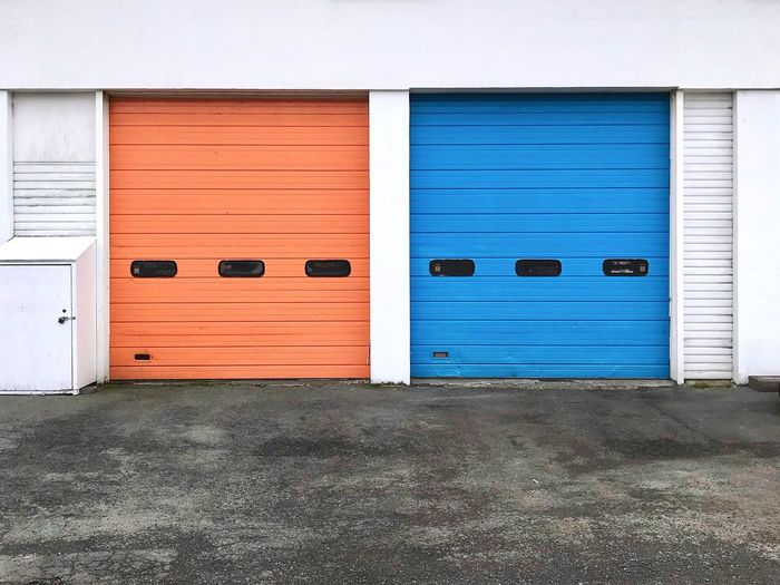 Options Orange Door Blue Door Built Structure Building Exterior Door Entrance Closed Wall - Building Feature No People Shutter Building Garage Metal Warehouse Industry Entrance Window Security Safety Protection Architecture Entrance Industry Business Day Transportation