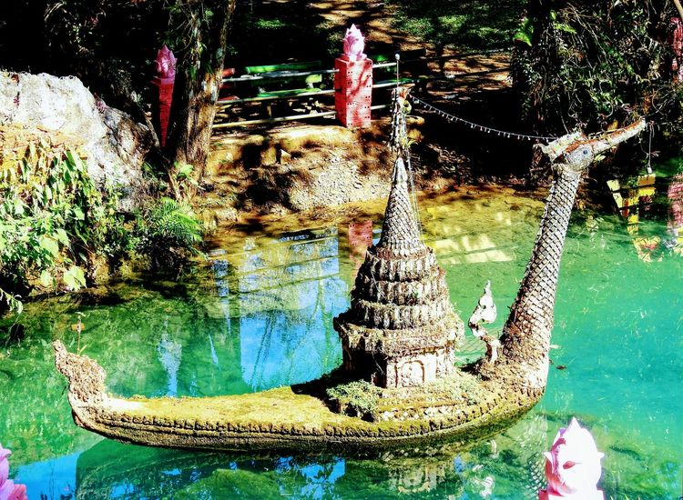 Pond in the temple. Tham Pha Phong. Chiang Mai. TH. Pond Pond Reflections Pond Water Water Reflection Day Outdoors No People Nature Beauty In Nature Monastery Travelling Thailand BUDDHISM IS LOVE Place Of Worship Focus On Foreground Beauty In Nature Trees Religion Travel Destinations Backgrounds Place Of Religion Temple Thailand Tranquility Low Angle View Multi Colored