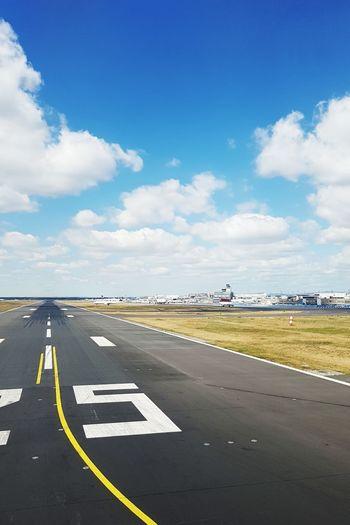 Empty runway against sky