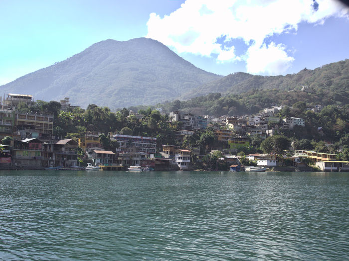 Goodbye Volcanoes! Architecture Atitlan Lake Beauty In Nature Building Exterior Built Structure Central America Cityscape Day Lake Mountain Nature No People On The Water Outdoors San Pedro Sky Travel Travel Destinations Travel Photography Tree Volcano Water