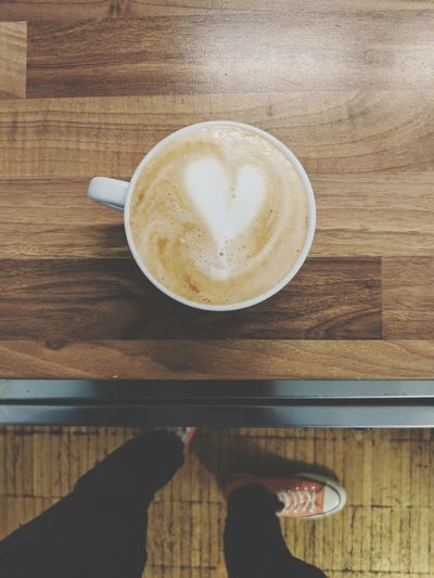 Froth Art Low Section Cappuccino Frothy Drink Human Hand Drink Latte Directly Above Human Leg Table