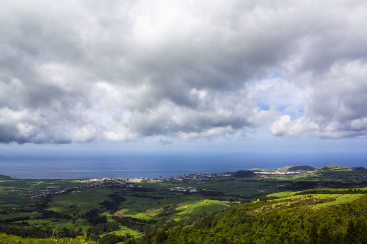 Azores Landscape Azores Farm Field Scenic Aerial View Beauty In Nature Cloud - Sky Coutryside Environment Fields Green Color Green Hills Green Island Hill Landscape Nature No People Non-urban Scene Ocean Outdoors Scenics - Nature Sea Tranquil Scene Tranquility Village Water