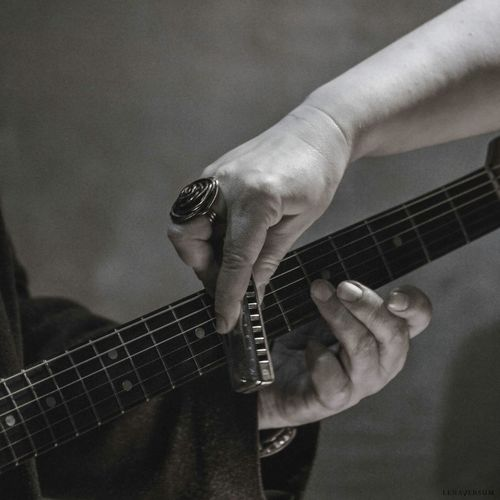 Midsection of men with guitar