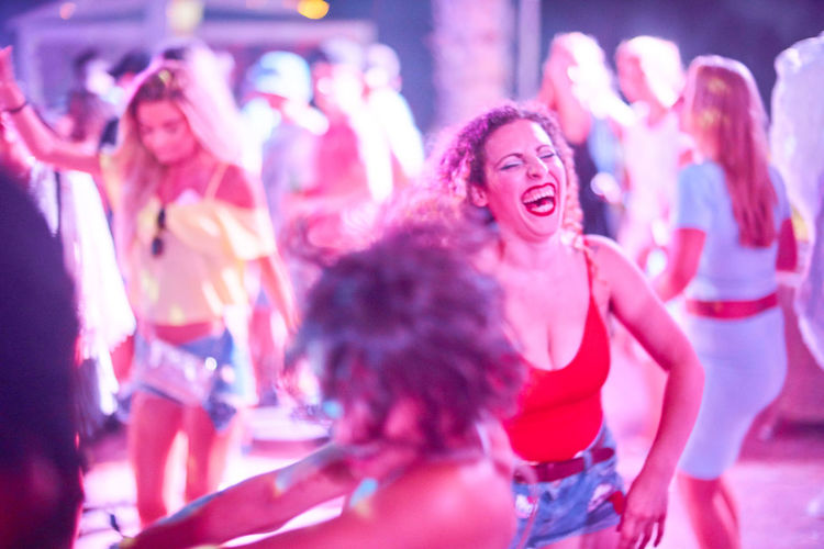 Young people dancing during party at nightclub