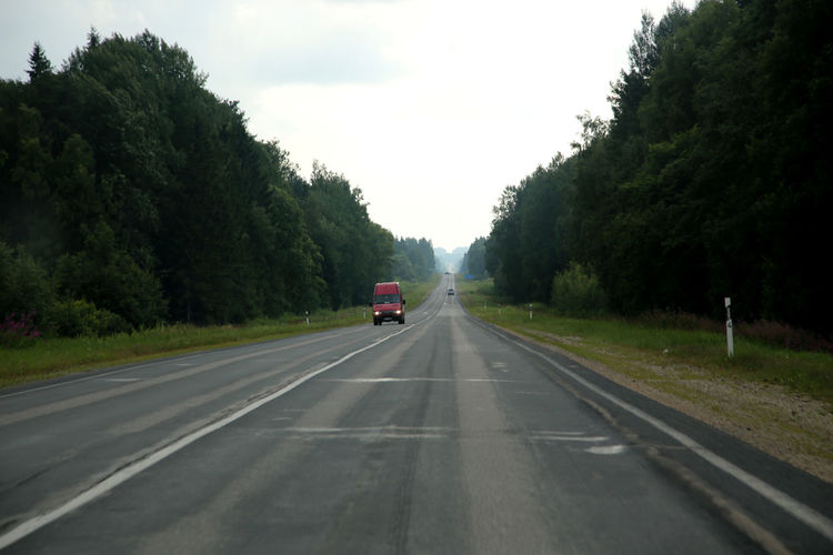 Latvian country road on overcast day Cloud Country Road Country Road Diminishing Perspective Empty Land Vehicle Latvia Latvia Riga Latvija Lettland  On The Move Reisen In Lettland Road The Way Forward Transportation Travelling In The Baltic States Travelling Latvia Vanishing Point