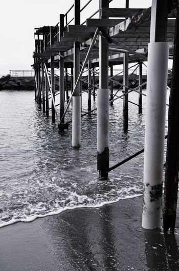 Pier stilts. Trampoli di molo. Black & White Black And White Blackandwhite Column Eye4photography  EyeEm Gallery Getting Away From It All Landscape_photography Leisure Activity Lifestyles Outdoors Pier Sea Sea View Sea_collection Seascape Seaside SUPPORT Taking Photos Water Weekend Activities Wood Wood - Material Wooden Wooden Post
