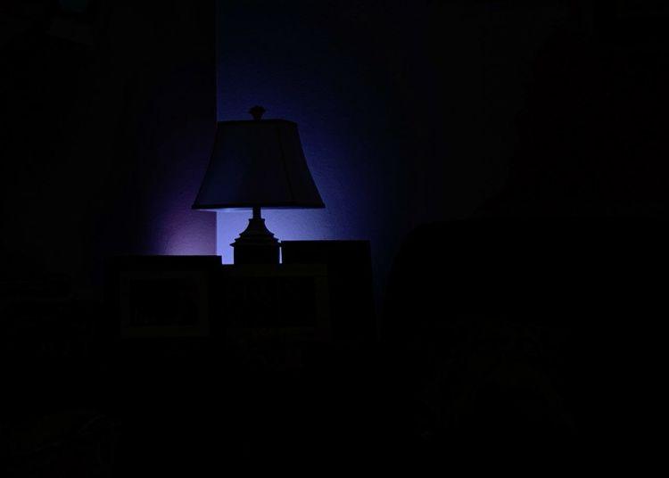 Illuminated lamp in dark room