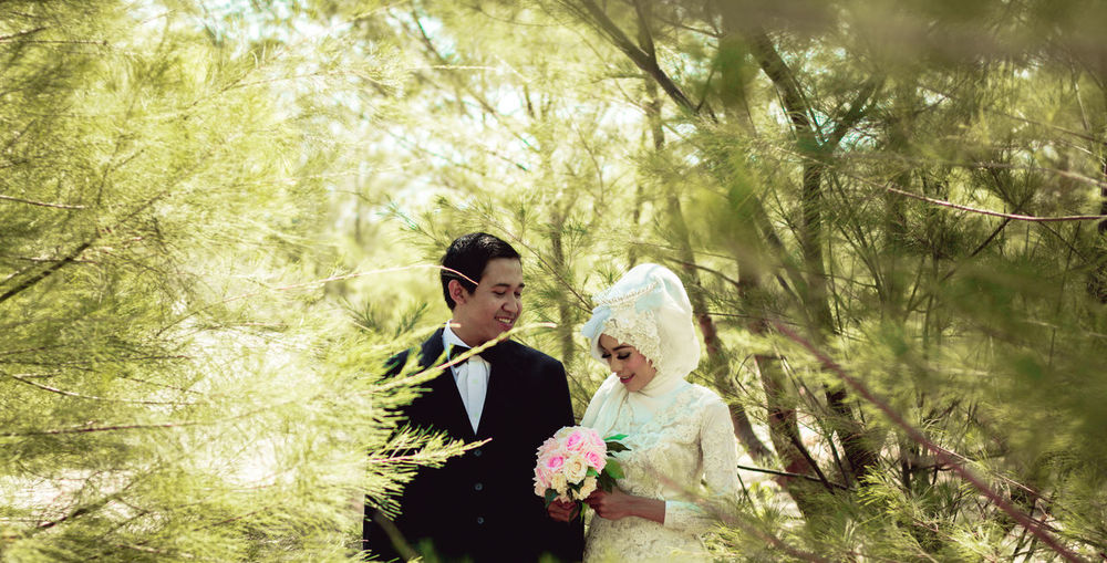 Love is You. Two People Adult Adults Only Togetherness Tree Day Wedding Bride Love Happiness Well-dressed People Wedding Dress Bridegroom Growth Wedding Ceremony Outdoors Flower Women Only Women